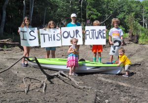 Kids along a dried up Ipswich River | Photo via Ipswich River Watershed Association